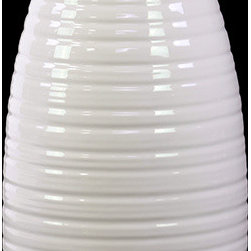 """Benzara - Dome Shaped Ceramic Vase With Etched Lines Design in White (Small) - The Dome Shaped Ceramic Vase With Etched Lines Design in White (Small) will give your home a fresh new look. Made from ceramic, the vase has a stylish dome shaped body with a simple yet elegant contemporary design. Tapering at the mouth, the ceramic vase widens as it reaches the bottom and has a wide base. Dressed in a lovely white shade, the ceramic vase is covered with lines from head to toe that is grand and simply eye candy. Use it as a standalone decor item or combine it with flowers and give your home a sprightly new look. The dimensions of the Dome Shaped Ceramic Vase With Etched Lines Design in White (Small) are 7.09""""x7.09""""x10.04""""H. Ceramic; White; 7.09""""x7.09""""x10.04""""H; Dimensions: 7""""L x 7""""W x 10""""H"""