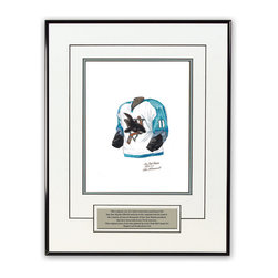 """Heritage Sports Art - Original art of the NHL 2003-04 San Jose Sharks jersey - This beautifully framed piece features an original piece of watercolor artwork glass-framed in a timeless thin black metal frame with a double mat. The outer dimensions of the framed piece are approximately 13.5"""" wide x 17.5"""" high, although the exact size will vary according to the size of the original piece of art. At the core of the framed piece is the actual piece of original artwork as painted by the artist on textured 100% rag, water-marked watercolor paper. In many cases the original artwork has handwritten notes in pencil from the artist. Simply put, this is beautiful, one-of-a-kind artwork. The outer mat is a clean white, textured acid-free mat with an inset decorative black v-groove, while the inner mat is a complimentary colored acid-free mat reflecting one of the team's primary colors. The image of this framed piece shows the mat color that we use (Silver). Beneath the artwork is a silver plate with black text describing the original artwork. The text for this piece will read: This original, one-of-a-kind watercolor painting of the 2003-04 San Jose Sharks uniform is the original artwork that was used in the creation of thousands of San Jose Sharks products that have been sold across North America. This original piece of art was painted by artist Nola McConnan for Maple Leaf Productions Ltd. The piece is framed with an extremely high quality framing glass. We have used this glass style for many years with excellent results. We package every piece very carefully in a double layer of bubble wrap and a rigid double-wall cardboard package to avoid breakage at any point during the shipping process, but if damage does occur, we will gladly repair, replace or refund. Please note that all of our products come with a 90 day 100% satisfaction guarantee. If you have any questions, at any time, about the actual artwork or about any of the artist's handwritten notes on the artwork, I would l"""