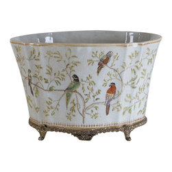 Oriental Danny - Hand painted porcelain planter - This hand painted porcelain planter is great size for floral arrangement. Hand painted with whimsical parrot on tree branches. Accent with bronze ormolu base.