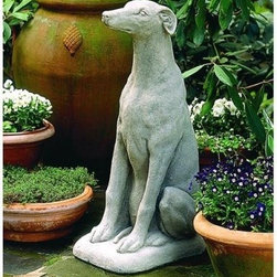 Greyhound Garden Statue - The proud stance of a racing Greyhound is unique to the breed. Celebrate your love of the elegant Greyhound with this unique and detailed outdoor statue. This well-mannered hound will always obey while you entertain outside.The Greyhound's smooth coat and muscular physique is beautifully carved in stone, using deep etchings that reveal a level of detail and craftsmanship that is unsurpassed. The carving is so realistic it may fool your own pets!The Greyhound dog comes in a variety of finishes to match the brick or stone of your outdoor decor. Order a set of two and place them on either side of an entryway for an impressive display.About Campania InternationalEstablished in 1984, Campania International's reputation has been built on quality original products and service. Originally selling terra cotta planters, Campania soon began to research and develop the design and manufacture of cast stone garden planters and ornaments. Campania is also an importer and wholesaler of garden products, including polyethylene, terra cotta, glazed pottery, cast iron, and fiberglass planters as well as classic garden structures, fountains, and cast resin statuary.Campania Cast Stone: The ProcessThe creation of Campania's cast stone pieces begins and ends by hand. From the creation of an original design, making of a mold, pouring the cast stone, application of the patina to the final packing of an order, the process is both technical and artistic. As many as 30 pairs of hands are involved in the creation of each Campania piece in a labor intensive 15 step process.The process begins either with the creation of an original copyrighted design by Campania's artisans or an antique original. Antique originals will often require some restoration work, which is also done in-house by expert craftsmen. Campania's mold making department will then begin a multi-step process to create a production mold which will properly replicate the detail and texture of the original piece. Depending on its size and complexity, a mold can take as long as three months to complete. Campania creates in excess of 700 molds per year.After a mold is completed, it is moved to the production area where a team individually hand pours the liquid cast stone mixture into the mold and employs special techniques to remove air bubbles. Campania carefully monitors the PSI of every piece. PSI (pounds per square inch) measures the strength of every piece to ensure durability. The PSI of Campania pieces is currently engineered at approximately 7500 for optimum strength. Each piece is air-dried and then de-molded by hand. After an internal quality check, pieces are sent to a finishing department where seams are ground and any air holes caused by the pouring process are filled and smoothed. Pieces are then placed on a pallet for stocking in the warehouse.All Campania pieces are produced and stocked in natural cast stone. When a customer's order is placed, pieces are pulled and unless a piece is requested in natural cast stone, it is finished in a unique patinas. All patinas are applied by hand in a multi-step process; some patinas require three separate color applications. A finisher's skill in applying the patina and wiping away any excess to highlight detail requires not only technical skill, but also true artistic sensibility. Every Campania piece becomes a unique and original work of garden art as a result.After the patina is dry, the piece is then quality inspected. All pieces of a customer's order are batched and checked for completeness. A two-person packing team will then pack the order by hand into gaylord boxes on pallets. The packing material used is excelsior, a natural wood product that has no chemical additives and may be recycled as display material, repacking customer orders, mulch,or even bedding for animals. This exhaustive process ensures that Campania will remain a popular and beloved choice when it comes to garden decor.Please note this product does not ship to Pennsylvania.
