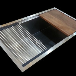 MicroLedge Kitchen Sinks - The MicroLedge Sink is a beautiful, elegant and practical custom kitchen sink. The sink features the ultraclean drain that eliminates over 17,000 bacteria from the basin. Available in length up to 7 feet, It can be installed as an undermount or drop in.