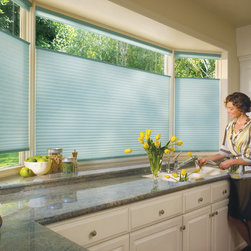 Hunter Douglas® Energy Effficent Honeycombs - Kitchen Window Shades - Kirkwood - These huge kitchen windows provide a great view into a luscious backyard but the sun beats through them every afternoon and that is why Hunter Douglas® Duette Architella Honeycomb shades with top down/bottum up were installed. The shades can be moved down when the sun is beating in, and put up when it is gone. The stack on these shades, when raised, is very minimal.