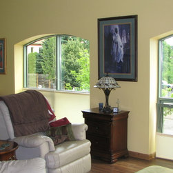 Specialty Windows - Floor Mounted roller shades in a second story condo.  Allow the customer to keep the look of the arch while providing privacy from the street below.  Also enables customer to use her windows.  Shades are always mounted on the floor.
