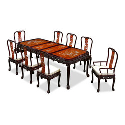 "China Furniture and Arts - 96in Rosewood Queen Ann Grape Motif Dining Table with 8 Chairs - Hand crafted of solid rosewood using traditional joinery technique by artisans in China and intricately inlayed with mother-of-pearl flowers decorate the entire table top and the chairs, table and chairs are laced with hand-carved grape motif along the edges. This rectangle dining set is an eye catching piece every time when you entertain. The table can be extended to 96"" with two 18"" removable leaves for your convenience. Hand applied dark cherry finish enhances the beauty of the pearl inlaid."