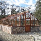 Tropic style greenhouse kits - 16x24 Greenhouse, redwood frame, on customer built stone base. Twin wall roof.