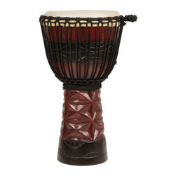 X8 Drums - X8 Drums Ruby Professional Djembe Drum - X8-PRO-RBY-L - Shop for Toy Instruments from Hayneedle.com! The X8 Drums Ruby Professional Djembe Drum is a masterpiece in both design and sound. It's hard to decide which is more impressive - the stunning ruby finish or the professional tonal range. This drum will last a lifetime and satisfy even the most discriminating percussionist. About X8 DrumsX8 Drums truly walks to the beat of their own drum. This family-owned company is committed to providing the best selection of high-quality musical instruments with an emphasis on world music percussion instruments. X8 Drums has certainly helped champion ethnic hand drums in the digital age thanks to its founders - a New York City rocker and an internet sage.