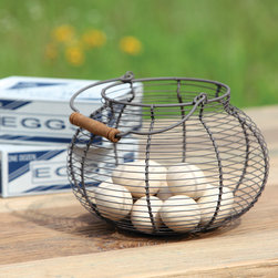 Wire Egg Basket - The perfect addition to your farmhouse style décor. A true country classic, this wire egg basket can be used to store freshly collected eggs or keep yarn tucked away.