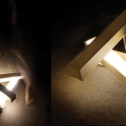 nu. an adjustable light sculpture. - An adjustable lighting piece inspired by the contemporary Japanese dance 'Butoh' - Four elongated rays of light representing limbs and joints, creating formations of expression linking body and mind in a form of dance with light.