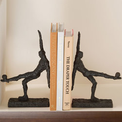 Soccer Kick Bookends - Whether expressing a passion for European football or a taste for Classical athlete sculptures, the Soccer Kick Bookends offer universal appeal, as the captured moment of balance and physical achievement looks dynamic and poised on your shelf or table.  A dark, rough natural metal finish keeps the mirrored soccer players in this pair of sport-themed bookends approachable and appealing.