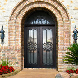 GlassCraft's Buffalo Forge Steel Double Door with Transom and Tivoli design - Buffalo Forge Steel Double Doors with Transom and Tivoli wrought iron grille design finished in Antique Bronze color