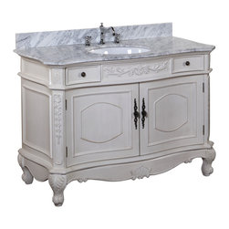 Kitchen Bath Collection - Versailles 48-inch Bath Vanity (Carrara/Cream) - This bathroom vanity set by Kitchen Bath Collection includes a cream cabinet with soft close drawers, Italian Carrara marble countertop, single undermount ceramic sink, pop-up drain, and P-trap. Order now and we will include the pictured three-hole faucet and a matching backsplash as a free gift! All vanities come fully assembled by the manufacturer, with countertop & sink pre-installed.