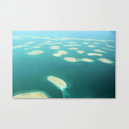 Man-Made Islands of Dubai Stretched Canvas - Dubai?s islands, often referred to as artificial, were planned and created to roughly resemble the world.  Individually trimmed and hand stretched, the Man-Made Islands of Dubai print will brighten up any space and keep the conversation going.