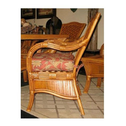 Spice Island Wicker - Dining Chair with Cushion (Jamaica Mist - All Weather) - Fabric: Jamaica Mist (All Weather)Crafted of bamboo and rattan with intricate woven detailing, this island inspired dining chair will be an inviting addition to any decor. Perfect for a summer cottage or a beachfront retreat, the chair is finished in cinnamon and features your choice of seat cushions. Cinnamon finish. Includes cushion. 28.5 in. D x 26.5 in. W x 39.5 in. H (20 lbs.)The distressed areas on the crushed Bamboo above. These are natural and are part of this material's character. These materials are merely decorative, so the frame of the chair is not affected.