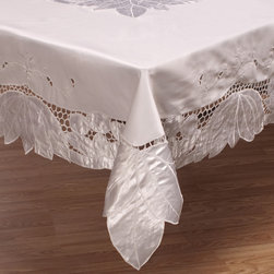 None - White 90-inch Round Cutwork Tablecloth - This white table cloth features a 90-inch round construction and is made of durable,100-percent polyester that is machine washable. Dress up your events,receptions,occasions and affairs with this beautiful,versatile table linen.