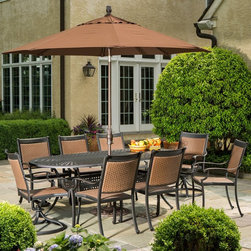 Alfresco Home - Pilot All-Weather Wicker Patio Dining Set - Seats 8 Multicolor - 22-1306 - Shop for Outdoor from Hayneedle.com! The Pilot All-Weather Wicker Patio Dining Set - Seats 8 is sure to be the new centerpiece of your outdoor furniture setup. Including a table and four chairs this set is built to last outdoors through all seasons. Each piece features an Antique Topaz finish on a black base with hand-applied rich gold and bronze accents. The weave-design tabletop is constructed from cast aluminum a worry-free solution to glass tabletops. Convenient resin wicker chairs are built for comfort with no cushion needed. The stationary chairs are fully assembled with no hardware to ever loosen. The table requires minor assembly and includes an umbrella hole with plug. Hose off to clean; never use harsh chemicals. Chlorine and salt water can cause the resin wicker to fade or crack when exposed to sunlight. We recommend hosing off daily if exposed to chlorine or salt water. Table dimensions: 87L x 42W x 29H inches. Chair dimensions: 30W x 27D x 43H inches. About Alfresco HomeOffering a wide selection of fashionable products from casual furniture and garden lighting to permanent botanicals and seasonal decor Alfresco Home casual living products offer a complete line of interior and exterior living furnishings and accents. Based out of King of Prussia Penn. Alfresco Home continues to blend indoor and outdoor furniture to create a lifestyle of alfresco living inside and outside of the home. Inlaid mosaic tabletops fine hardwood furnishings artisan-inspired accents premium silk botanicals and all-weather wicker sets are just a few examples of the kind of treasures you'll find in Alfresco's specially designed collections. Please note this product does not ship to Pennsylvania.