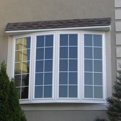 Bows and Bay windows - Exterior view of a built out bow with 4 casement windows.