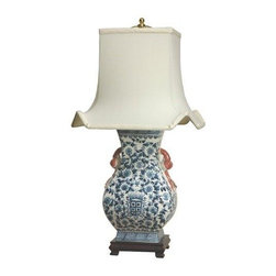 "Oriental Furniture - 27"" Floral Blue & White Porcelain Lamp - Elegantly hand-crafted by artisans in China's Guangdong province, this beautiful piece combines a Song dynasty style porcelain vase with a carved wooden base. The porcelain part of the lamp features a classic blue and white design sure to add a colorful accent to any room. A fabric shade on a steel frame completes the design. This porcelain lamp features a three-way light fixture and includes a soft hand made shade."