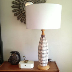 Mid-Century Plaid Ceramic Table Lamp - Who doesn't love plaid? This table lamp is definitely Donald Draper approved and sure to be a conversation piece in your home. The plaid pattern is painted on ceramic or porcelain body with what looks like teak wood base. Wired and in working condition. Shade is not included.
