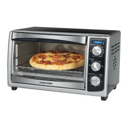 "Applica Consumer Prod - 6 Slice Convection Oven - Toasts up to 4 bagel halves, 6 slices of bread or 12"" pizza. Back of oven has 12"" pizza bump. Bakes, broils, toasts and reheats a variety of foods. Full range thermostat; 60-minute timer with audible signal and auto shutoff. Baking and toast signal bell.   Swing open crumb tray for easy cleaning. Non-stick easy wipe to clean interior. Quartz heating element. Includes broiler rack that advances for easy food removal. Dimensions: 19 x 13 x 12. Black."