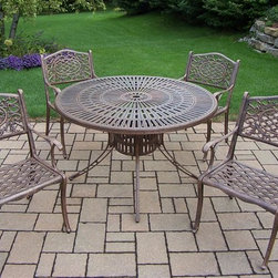 Oakland Living - 5-Pc Cast Aluminum Round Dinning Set - Includes sunray table, four chairs and metal hardware. Traditional lattice pattern and scroll work. Handcast. Hardened powder coat and rust free. Fade, chip and crack resistant. Warranty: One year limited. Antique bronze finish. Minimal assembly required. Table: 48 in. Dia. x 29 in. H. Chair: 22.5 in. W x 22 in. D x 35 in. H (23 lbs.)The Oakland Mississippi collection combines grace style and modern designs giving you a rich addition to any outdoor setting. We recommend that the products be covered to protect them when not in use. To preserve the beauty and finish of the metal products, we recommend applying an epoxy clear coat once a year. However, because of the nature of iron it will eventually rust when exposed to the elements.