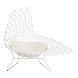 "Knoll - Bertoia Asymmetric Chaise - The Bertoia Asymmetric Chaise was never produced beyond prototypical form until 2005, when Knoll brought this masterpiece of mid-century experimental design into production. With his iconic seating collection, Harry Bertoia transformed industrial wire rods into a new furniture form. The events that made this work possible began a decade earlier at Cranbrook Academy of Art when Bertoia met Florence Knoll Bassett (then Florence Schust). Years later, the Italian-born designer was invited to work for Florence and her husband Hans Knoll. The terms were favorable to the artist and Bertoia was given the freedom to work on whatever suited him, without being held to a strict design agenda. The result of this arrangement was the Bertoia Seating Collection (1952). Featuring a delicate filigreed appearance that's supremely strong, these airy seats are sculpted out of steel rods. In his art, Bertoia experimented with open forms and metal work, and these chairs were an extension of that work. ""If you look at the chairs, they are mainly made of air, like sculpture,"" said Bertoia. ""Space passes through them,"" After designing his seating collection, Bertoia returned to focusing mostly on sculpture. His work was often used in projects by Eero Saarinen (another Cranbrook friend), notably at MIT and the Dulles International Airport. Of the highest quality, it takes two craftsmen two days to make one Asymmetric Chaise. The white chaise can be used outdoors with proper care and limited exposure to the elements. Manufactured by Knoll according to the original and exacting specifications of the designer. Made in Italy."