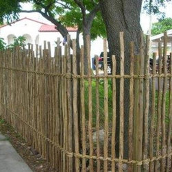 """Residential - Rustic Eucalyptus Fencing is made from random height eucalyptus poles that are arsenic-free treated.  They are spaced just under 4"""" apart, held together by 2 galvanized steel bars which are hidden from view by polyester rope lashing."""
