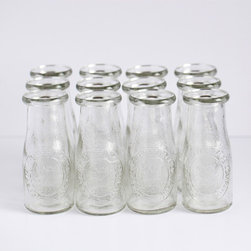 Small Glass Milk Bottles - I love these miniature replicas of old-fashioned milk bottles. I use my set all the time for after-school snacks or birthday parties, and they even become the occasional bud vases. They are the perfect glassware for single servings of milk.