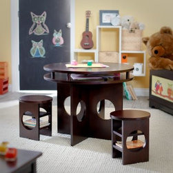 Classic Playtime Round Storage Table and Chair Set - Espresso - The Classic Playtime Round Storage Table and Chair Set - Espresso makes a great place for children to share a meal or play a game. This furniture set features a dark brown multi-step painted finish on each item. The table and chairs are all made from sturdy MDF, an engineered wood that is highly resistant to cracking and warping. Plus, the modern circular cut-out design looks great anywhere. Each stool features two shelves under the seat, perfect for storing story or coloring books. A storage space under the table top offers additional room for art supplies. Chair dimensions: 12.75L x 11W x 11H inches. Table dimensions: 29 diam. x 21H inches.