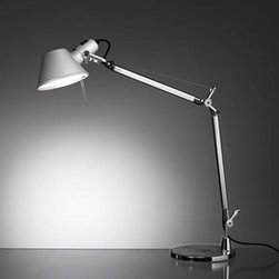 Artemide - Tolomeo mini table lamp - The Tolomeo mini table lamp from Artemide has been designed by Michele De Lucchi and Giancarlo Fassina. This table mounted luminaire is wonderful for adjustable direct task incandescent lighting. The Tolomeo mini comes equipped with fully adjustable articulated arm body structure in extruded brilliant, natural anodized aluminum. The joints, tension control knobs, and mountings are in polished die-cast aluminum. The diffuser is made of stamped, anodized matte aluminum, which is rotatable 360 degrees. The Tolomeo mini table lamp is a contemporary and practical way to illuminate small spaces