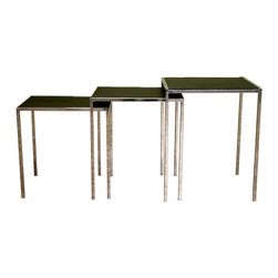 Wholesale Interiors - Baxton Studio Nesting Tables in Chrome & Blac - You'd expect to pay this price for one table, but with this fabulous Baxton Studio set, you get three of graduating sizes. Set includes one square and two smaller rectangular end tables, perfect for when you are entertaining friends or family. Sleek contemporary design includes sturdy metal frames with a dazzling chrome finish and contrasting black bonded leather tops. Decorative contrast topstitching adds an added touch of elegance to this classic design. Includes three tables. Black bonded Leather tabletops. Tan contrasting stitching on each tabletop. Contemporary table frame in chromed steel. Opaque plastic floor protectors. Largest Table: 17.75 in. W x 17.75 in. D x 22 in. H. Medium Table: 16.25 in W x 17.75 in. D x 20.25 in H. Smallest Table: 15 in. W x 17.75 in. D x 18.25 in. HThese modern nesting tables easily take the spotlight, and for good reason: not only are they versatile and multifunctional, but they are stylishly topped with black bonded leather, which is easy to wipe clean. Running along each edge of the leather tabletop is a single line of contrasting stitching in a tan color. The frames of the contemporary tables are hardy steel and built-to-last. The svelte base is topped and finished with high-shine chrome and each table is sized just right to fit underneath the next with minimal empty space remaining. Opaque plastic non-marking feet are included.