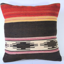 Antique Turkish Kilim Pillow Cover by Pearly Notes - These pillow covers are repurposed from antique kilim rugs that were made using a Persian weaving technique. The designs feel very modern but can also be enjoyed by those who appreciate history and ancient crafts. This pillow would pair perfectly with rustic and vintage elements.