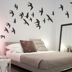 """Binary Box - Swallows Wall Stickers - This dramatic flock of the Swallows Wall Stickers adds flare and spectacle to any room. A stunning, bold focal point, these Swallow wall stickers will transform your bedroom or living room into an open sky filled with flocks of birds. Each swallow can be applied individually, meaning you can arrange them on your wall however you like and let your creativity fly. This pack contains twenty-five (25) swallow wall stickers, each swallow measuring approximately 6.3"""" x 6.3."""""""