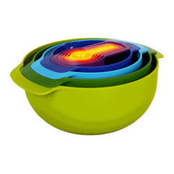 Joseph Joseph - Joseph Joseph Nest Bowl Set, Multicolor - Our Nest range is the ultimate collection of practical, space-saving kitchenware, comprising of mixing bowls, measuring spoons, a sieve, strainer and juicer. The unique design of the range allows the individual elements of each set to be stacked together, thereby occupying the absolute minimum amount of space. Available in a range of bright, vibrant colours, all pieces are dishwasher safe. Set includes 4 measuring cups (1/4, 1/3, 1/2 & 1cup), a sieve, a colander, small mixing bowl with measuring marks (17 fl oz) and a large bowl with non-slip base (152 fl oz).