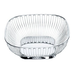 Alessi - Square Wire Basket by Alessi - The Alessi Square Wire Basket is part of a family of open, airy and gleaming folded wire baskets designed by Ufficio Tecnico Alessi. The stainless steel Square Wire Basket is ideal for storing fruit, vegetables and other goodies in the kitchen or dining room with modern, metallic style.Alessi, known as the Italian design factory, has manufactured household products since 1921, the stylish and fun items offered are the result of contemporary partnerships with some of the world's best designers of unique and modern home accessories.The Alessi Round Wire Basket is available with the following:Details:Made of 18/10 stainless steelMirror Polished finishDesigned by Ufficio Tecnico AlessiShipping: In Stock items ship within 1 business day. Others usually ship within 2 weeks unless otherwise noted.