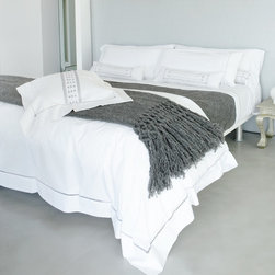 Sefte - Sefte Neama Charcoal Duvet Cover - Relaxation becomes rejuvenation with the inspired and luxurious designs of Sefte. Embracing the age old tradition of their past while creating social and financial independence, artisans from Vietnam hand embroider the delicate Neama border design on this organic Italian cotton duvet. The elegant 400 threadcount duvet is white with charcoal stitching.  Available in Queen, King, and California King.