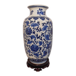 "Oriental Furnishings - Blue and White Wide Mouth Vase in Daisey Chain Pattern - Our water tight Blue and White porcelain Vase is the perfect flower vase with its large mouth feature. The 14"" height works well on any table top and its simple floral design is beautiful as a focal point or will coordinate nicely with your other collectibles. This vase is painted in a traditional Asian daisy chain pattern, with top and bottom arabesque. This authentic Chinese porcelain, imported by us will bring years of pleasure and usefulness. Use on a hall chest or table with or without a flower arrangement.  Enhance this vase with one of our wooden vase stands (available separately)."