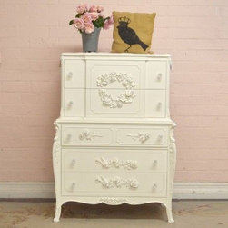 Elegant White Highboy Dresser with 5 Drawers - This pretty highboy features 5 drawers. The drawers have a lovely, gently curving sides and the piece has long elegant legst. A stunning piece for any bedroom! Painted white and features our popular appliques and glass knobs.