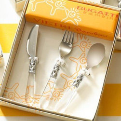 """Vietri Bambini Child's Kids Aladdin Clear Flatware Set of 3 - The Aladdin Clear 3-piece child's flatware set is the perfect gift for the newborn! The set features latticed metalwork in a brilliant finish on the handle and 18/10 stainless steel. The set is made in Lumezzane, Italy by the Bugatti family. Dishwasher safe, please use the low energy/air dry cycle, with handles up in the basket.  The VIETRI brand combines the richness of European culture with a sophisticated American spirit. Fashion forward, yet classic, Italian home accessories are designed to complement the good life and celebrate Italy and all that it encompasses -- a love of life, people, nature, and simply good living. VIETRI means romance, love, timeless design, the care and talent of many hands to create and share beauty.  For over 25 years, VIETRI has provided high-quality, handcrafted products for homes and gardens that promote the essence of the Italian lifestyle.  The VIETRI brand includes collaborative designs from the best of Italian culture that capture and preserve the inspirations of our legacy. Easch piece measures approximately 6"""" Long"""