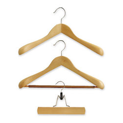 "Premium Natural Hardwood Hangers - After reading ""Lessons From Madame Chic,"" I am paring down my closet to 10 capsule items for each season. Knowing I have fewer clothes, but clothes of high quality, reminds me to take extra care of what I do have. With that said, choose wooden hangers that maintain the shape of your clothing and also look aesthetically pleasing."