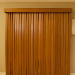 Vertical Wood Blinds - Made in the USA. These traditional vertical wood blinds are 100% wood and have no visible finger joints. Available in 17 colors. Shown in Sun Kissed Oak. Ship from Holland, Michigan.