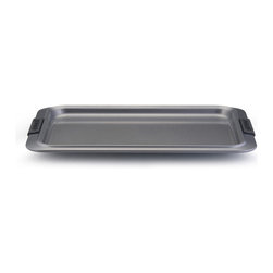 """Anolon Advanced Bakeware 10"""" x 15"""" Cookie Pan - Bake scrumptious cookies  savory treats and more with the Anolon Advanced Nonstick Bakeware 10-"""" by 15-"""" Cookie Sheet with Silicone Grips. This versatile cookie pan is designed to make baking easier and more efficient  while measuring up to the high standards of serious bakers. Constructed of heavy-duty carbon steel in a medium color tone that aids in even browning  this cookie sheet resists warping and provides the even heat distribution that is so critical for successful baking results.  Product Features      Heavy duty carbon steel construction   Anolon SureGrip handles for a comfortable grip   Oven safe to 450 Degrees F   Durable nonstick surface allows for effortless food release   Limited lifetime warranty"""