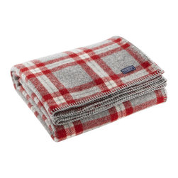 Faribault Mill - Soho Wool Throw - Gray/Red Plaid - Some of the best things come from finding use in what would otherwise be discarded. That's what happened at Faribault Woolen Mill prior to its closing in 2008. With remnant yarn from dwindling inventory, the Soho throw (short for stuff-on-hand-only) was made and it has become a mill favorite since the mill's reopening.We are proud to keep this design alive in a variety of colorways that give a layer of comfort and tradition to any home décor. 100% wool. Dry clean only. Made in America.