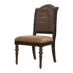 Frontgate - Isla Green Side Chair - Dark, heavily distressed Tamarind finish accentuates the richly carved legs and scroll accents on the back. Tight seat with rich tapestry-patterned upholstery. Assembly required. Coordinates with other items from our Tommy Bahama Kingstown collection. With classic British Colonial styling, our Isla Verde Side Chair brings a touch of the exotic to the familiar. An open-caned back, intriguing dark finish and tapestry-patterned upholstery, infused with spice tones, are layered over a traditional silhouette and ornately turned legs - creating a versatile design that can play elegant or relaxed.  .  .  .  .