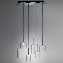 AXO Light - Spillray 6-Light Pendant by AXO Light - The AXO Light Spillray Multi-Light Pendant seems to twinkle with light as small halogen bulbs illuminate each Pyrex glass shade and create beautiful shapes throughout a space. These upside-down goblets, each a different size, make for a stunning centerpiece over the contemporary dining room table. Italy's AXO Light combines traditional Venetian glasswork and artisan craftwork with avant-garde lighting techniques and innovative materials. Their design philosophy is clear: use creativity and inspiration to create stunning lighting replete with value and emotion.