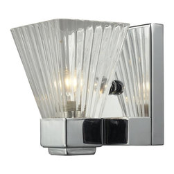 One Light Chrome Clear Ribbed Glass Bathroom Sconce - This extravagant single light wall sconce consists of a clear ribbed shade and is shown with a chrome frame.  This eye-catching light is also available with a brushed nickel finish as well.