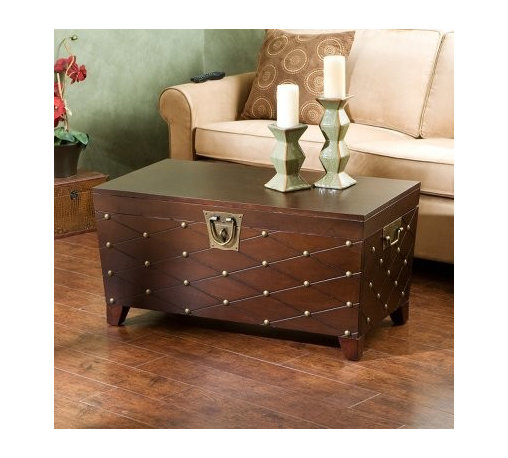 Southern Enterprises Nailhead Coffee Table Trunk - Espresso - Cool coffee table. That's what your guests will say when they see the Espresso Nailhead Coffee Table Trunk. Its head-turning design features antique gold-finished nailheads placed at the intersections of the grooved diamond pattern. This coffee table offers chic worldly appeal and plenty of usefulness. There's ample room on the sturdy flat top for refreshments or reading material. The sturdy lid opens to reveal a large storage area for pillows blankets magazines and other items. Durable metal hardware handles and a decorative padlock latch round out the piece. Assembly required. Tip: You can pair the coffee table with the matching Espresso Nailhead End Table Trunk for a complete set.About SEI (Southern Enterprises Inc.)This item is manufactured by Southern Enterprises or SEI. Southern Enterprises is a wholesale furniture accessory company based in Dallas Texas. Founded in 1976 SEI offers innovative designs exceptional customer service and fast shipping from its main Dallas location. It provides quality products ranging from dinettes to home office and more. SEI is constantly evolving processes to ensure that you receive top-quality furniture with easy-to-follow instruction sheets. SEI stands behind its products and service with utmost confidence.