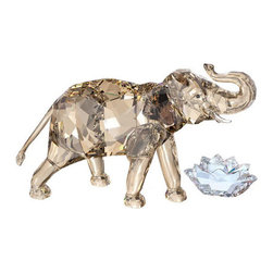 "Swarovski - Swarovski 2013 Annual Edition SCS Cinta Elephant - Swarovski 2013 Collector's Society SCS Annual Edition - Cinta Elephant  -  RETIRED - LIMITED AVAILABILITY  -  Size: 4.5"" Tall x 6.5"" Wide  -  It comes with the Crystal Moonlight title plaque in the shape of a lotus flower  -  The SCS Members Elephant is created in Crystal Light Sand Color  -  Cinta's tail design allows the Young Elephant's (sold seperately) upturned trunk to wrap around it in an adorable expression of harmony and motherly love.  -  The enchanting Elephant Cinta name means love in Indonesian. This Asian Elephant can be distinguished from its African counterpart by their smaller ears.  -  Engraved with Cinta 2013 and the designer Elisabeth Adamer's signature"