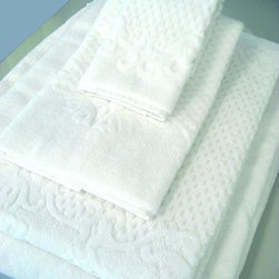 Comforting and Luxurious Bath Details - The Heirloom Collection line of luxury organic cotton towels! This is an elegant jacquard design available in ivory white from Nandina Green.
