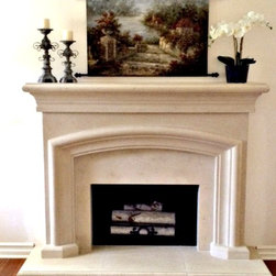 French Country Cast Stone Mantel - French Country Mantel.......From the countryside In southern France. This mantel invites the warmth of your home. Shown in bone with lite pit texture. Hearth and fillers included. Visit our website for textures and more colors.