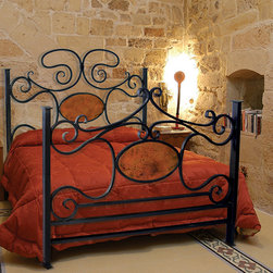 Alexander Bed with Copper - This luxurious, hand forged wrought iron bed is certain to put you to sleep in the most elegant way possible. Hand crafted with an industrial flair designed to accentuate the process of construction and create a clean, rugged and primitive appearance. Some customization is available for an up-charge in price.
